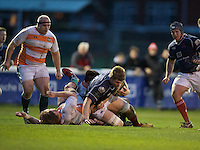 Freddie Clarke of London Scottish Football Club is tackled during the Greene King IPA Championship match between London Scottish Football Club and Ealing Trailfinders at Richmond Athletic Ground, Richmond, United Kingdom on 26 December 2015. Photo by Alan  Stanford / PRiME Media Images