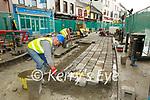 John Horgan laying down cobbles on Main Street Killarney on Monday