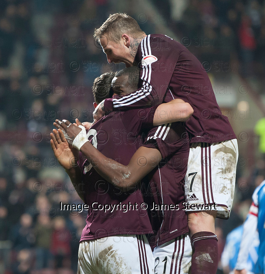 Hearts' John Sutton is congratulated by .Ryan Stevenson and Michael Ngoo  after he scores their second goal.