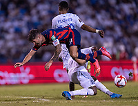SAN PEDRO SULA, HONDURAS - SEPTEMBER 8: Christian Pulisic #10 of the United States is tackled in the box during a game between Honduras and USMNT at Estadio Olímpico Metropolitano on September 8, 2021 in San Pedro Sula, Honduras.