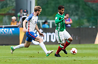 Mexico City, Mexico - Sunday June 11, 2017: Tim Ream, Jonathan dos Santos during a 2018 FIFA World Cup Qualifying Final Round match with both men's national teams of the United States (USA) and Mexico (MEX) playing to a 1-1 draw at Azteca Stadium.