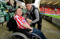 Lincoln City's Tom Pett with fans prior to the game<br /> <br /> Photographer Chris Vaughan/CameraSport<br /> <br /> The EFL Sky Bet League One - Lincoln City v Sunderland - Saturday 5th October 2019 - Sincil Bank - Lincoln<br /> <br /> World Copyright © 2019 CameraSport. All rights reserved. 43 Linden Ave. Countesthorpe. Leicester. England. LE8 5PG - Tel: +44 (0) 116 277 4147 - admin@camerasport.com - www.camerasport.com