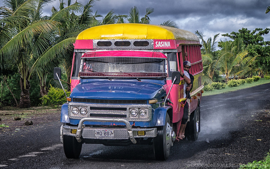One of many multicolor busses that serve as the main source of transportation for the islanders of Western Samoa.