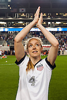United States (USA) defender Becky Sauerbrunn (4) salutes the fans after the game. The women's national team of the United States defeated the Korea Republic 5-0 during an international friendly at Red Bull Arena in Harrison, NJ, on June 20, 2013.