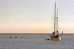 Kayakers leaving a sailboat, Corona del Mar, CA.