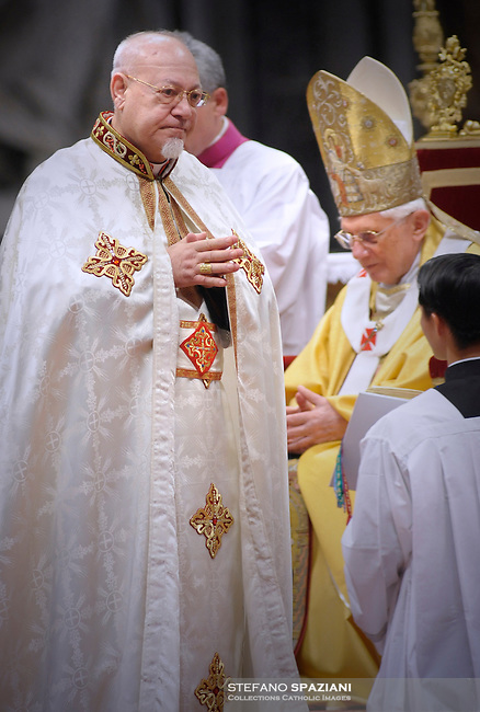 Pope Benedict XVI (L) gives his cardinal ring to Egyptian Antonios Naguib (R) during the Eucharistic celebration with the new cardinals on November 21, 2010 at St Peter's basilica at The Vatican. 24 Roman Catholic prelates joined the day before the Vatican's College of Cardinals, the elite body that advises the pontiff and elects his successor upon his death.