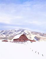Old barn in Winter near Steamboat Springs ski area, Colorado.