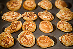 Poffertjes, small dutch pancakes, are ready for eating on the Albert Cuyp Market in Amsterdam.