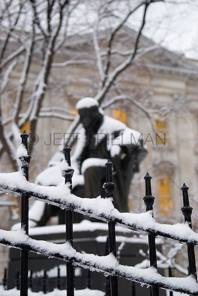 Statue of Horace Greely (founder of The New York Tribune newspaper) in City Hall Park after a Snow Storm, Civic Center, Lower Manhattan, New York City, New York State, USA