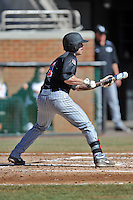 UNLV Runnin' Rebels center fielder Joey Swanner #1 squares to bunt during a game against the Tennessee Volunteers at Lindsey Nelson Stadium on February 22, 2014 in Knoxville, Tennessee. The Volunteers defeated the Rebels 5-4. (Tony Farlow/Four Seam Images)