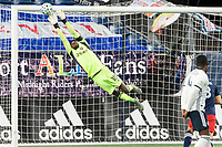 FOXBOROUGH, MA - OCTOBER 19: Andre Blake #18 of Philadelphia Union saves a goal off a free kick during a game between Philadelphia Union and New England Revolution at Gillette on October 19, 2020 in Foxborough, Massachusetts.