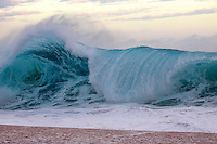 A big breaking wave on the North Shore of O'ahu.
