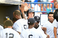 Tampa Yankees outfielder Aaron Judge (59) high fives CC Sabathia (52) after scoring a run during a game against the Dunedin Blue Jays on June 28, 2014 at George M. Steinbrenner Field in Tampa, Florida.  Tampa defeated Dunedin 5-2.  (Mike Janes/Four Seam Images)