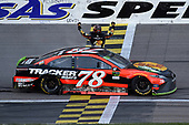 Monster Energy NASCAR Cup Series<br /> Hollywood Casino 400<br /> Kansas Speedway, Kansas City, KS USA<br /> Sunday 22 October 2017<br /> Martin Truex Jr, Furniture Row Racing, Bass Pro Shops / Tracker Boats Toyota Camry, celebrates after winning.<br /> World Copyright: John K Harrelson<br /> LAT Images