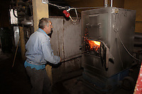 Polish employee in charge of the charcoal heating system of the URiC Radom centre.