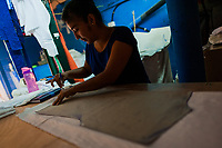 A Salvadoran seamstress draws on a white fabric, dyed with the natural blue indigo afterwards, in an artisanal clothing workshop in Santiago Nonualco, El Salvador, 6 April 2018. For centuries, indigo, a natural deep blue dye extracted from the leaves of tropical plants, has been known to the native indigenous inhabitants of Central America. Nowadays, a growing demand for handmade, nature-based products has has permitted the emergence of various clothing workshops and cooperatives. Employing traditional design techniques and inspired by the ancient Mayan artists, they produce fashion collections, clothing accessories or decorative items on a sustainable, small scale basis.