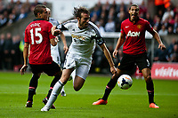 Saturday 17 August 2013<br /> <br /> Pictured: Michu of Swansea runs throught the Manchester United Defence<br /> <br /> Re: Barclays Premier League Swansea City v Manchester United at the Liberty Stadium, Swansea, Wales