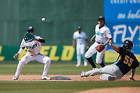 Lynchburg Hillcats shortstop Yordys Valdes (7) waits for a throw as Jacob Wetzel (55) of the Myrtle Beach Pelicans slides into second base at Bank of the James Stadium on May 23, 2021 in Lynchburg, Virginia. (Brian Westerholt/Four Seam Images)