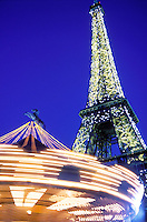 France, Paris, The Eiffel Tower illuminated and carousel