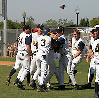 March 29, 2005:  Pitcher Dennis Raben (right - no hat) of St. Thomas High School celebrates with teammates after a game at Bishop Moore Catholic High School in Orlando, FL.  Raben got the win on the mound defeating nationally top ranked Monsignor Pace.  Raben attended Miami University and was drafted in the 2nd round of the 2008 MLB amateur draft by the Seattle Mariners as an outfielder.  Photo By Mike Janes/Four Seam Images