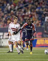 Chicago Fire midfielder Logan Pause (7) passes ball back away from New England Revolution forward Kheli Dube (11). The New England Revolution tied the Chicago Fire, 0-0, at Gillette Stadium on October 17, 2009.