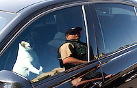 Seattle Animal Control officer Matthew Belue checks on a dog locked in a car in parking lot in Ballard in Seattle, Wash. on May 8, 2015. It was 68 degrees outside which can very quickly rise 15 degrees higher in a parked car. A concerned citizen noticed the dog panting and called animal control 30 minutes later. The owner returned to the car some time after Officer Belue arrived and the dog was alright. (© Karen Ducey Photography)