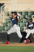 Grenny Cumana (12) of the Lakewood BlueClaws follows through on his swing against the Kannapolis Intimidators at Kannapolis Intimidators Stadium on August 11, 2016 in Kannapolis, North Carolina.  The Intimidators defeated the BlueClaws 3-1.  (Brian Westerholt/Four Seam Images)