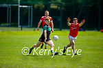 Churchills Damien Doherty gets his effort away despite the attempted block by Joe O'Connor of St Pats Blennerville in the County Senior football league on Sunday.