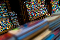 Hundreds of used books are seen stacked in shelves on the street in a secondhand bookshop in San Salvador, El Salvador, 12 April 2018. Large collections of worn-out books, mostly textbooks and educational paperbacks, are sold regularly in secondhand bookshops in the center of the city.