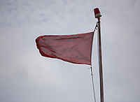 Thursday 15 June 2017<br /> Pictured: A red flag flying by one of the gates of Castlemartin range.<br /> Re: A soldier has been killed and three others injured after an incident involving a tank at a Ministry of Defence base in Pembrokeshire.<br /> The soldier, from the Royal Tank Regiment, died in the incident at Castlemartin Range.<br /> Two people were taken to Morriston Hospital in Swansea, while another casualty remains in Cardiff's University Hospital of Wales.<br /> An investigation is under way.<br /> Live firing was scheduled to take place at the range between Monday and Friday.<br /> In May 2012, Ranger Michael Maguire died during a live firing exercise at the training base. An inquest later found he was unlawfully killed.