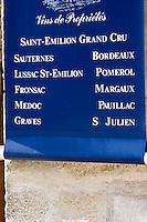 Wine shop with sign: Saint Emilion Grand Cru, Sauternes, Bordeaux, Lussac-St-Emilion, Pomerol, Fronsac, Margaux, Pauillac, Medoc, Graves, St Julien. The town. Saint Emilion, Bordeaux, France