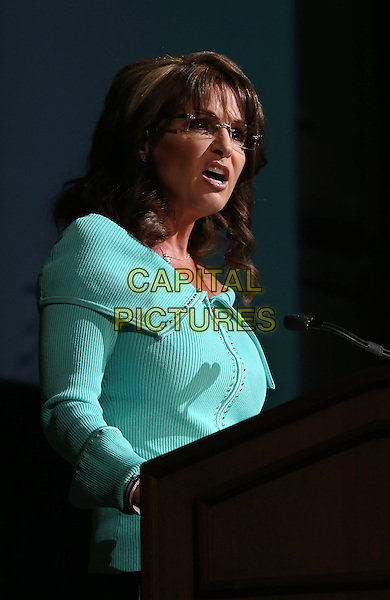 Sarah Palin.Women's Resource Medical Centers of Southern Nevada Hosts 28th Annual Shareholders in Life Banquet & Silent Auction Featuring Keynote Speech from Governor Sarah Palin at The Rio, Las Vegas, NV, USA, 26th April 2013..half length jacket suit speaking microphone podium green glasses .CAP/ADM/MJT.© MJT/AdMedia/Capital Pictures