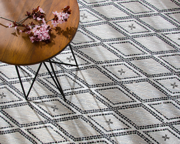 Rimini, a hand-cut stone mosaic, shown in hand-chopped tumbled Cashmere, Afyon White, and Saint Laurent, is designed by Paul Schatz as part of the Legend® collection by New Ravenna.
