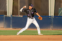 University of Washington Huskies AJ Graffanino (11) makes a throw to first base against the Cal State Fullerton Titans at Goodwin Field on June 10, 2018 in Fullerton, California. The Huskies defeated the Titans 6-5. (Donn Parris/Four Seam Images)
