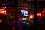 BROOKLYN, NY — OCTOBER 12, 2020:  The final U.S. Presidential Debate between President Donald Trump and former Vice President Joe Biden is broadcast on a TV above a bar in a restaurant on on October 22, 2020 in Brooklyn, NY.  Photograph by Michael Nagle