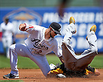 Reno Aces' Sean Jamieson puts the tag on Salt Lake Bees' Quintin Berry at Greater Nevada Field in Reno, Nev., on Tuesday, June 7, 2016. <br />