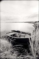 Rowboat pulled onto shore<br />
