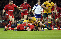 Pictured: Rhys Priestland of Wales (with ball) is brought down by James Slipper of Australia. Saturday 08 November 2014<br />