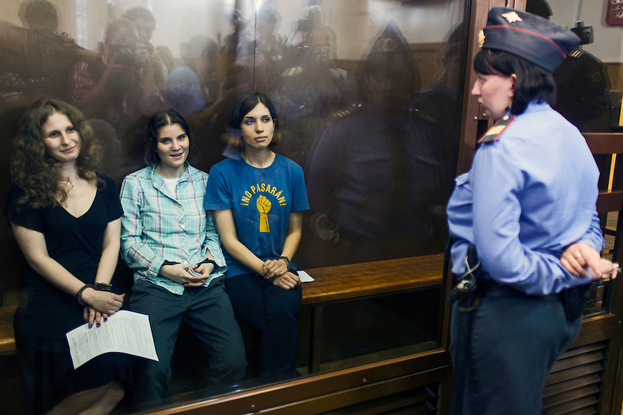 17/08/2012, Moscow, Russia..Maria Alyokhina, Yekaterina Samutsevich and Nadezhda Tolokonnikova of punk band Pussy Riot inside the courtroom's glass cage after being sentenced to two years in prison for their performance in the Christ The Saviour Cathedral.