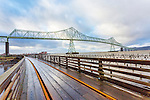 Trolly tracks, boardwalk, and Astoria-Megler Bridge, Columbia River, a steel girder continuous truss bridge spanning the Columbia River between Astoria, Oregon and Point Ellice, Megler, Washington, United States.  Total span 14 miles.  It is the longest continuous bridge in North America.
