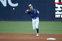 Durham Bulls shortstop Jake Cronenworth makes a throw to first base against the Louisville Bats at Durham Bulls Athletic Park on May 28, 2019 in Durham, North Carolina. The Bulls defeated the Bats 18-3. (Brian Westerholt/Four Seam Images)