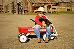 Puppy Love! Cash holding Buddy, on. the ranch in San Luis Obispo, California