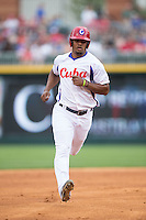 Yosvani Alarcon Tardio (11) of the Cuban National Team runs the bases against the US Collegiate National Team at BB&T BallPark on July 4, 2015 in Charlotte, North Carolina.  The United State Collegiate National Team defeated the Cuban National Team 11-1.  (Brian Westerholt/Four Seam Images)