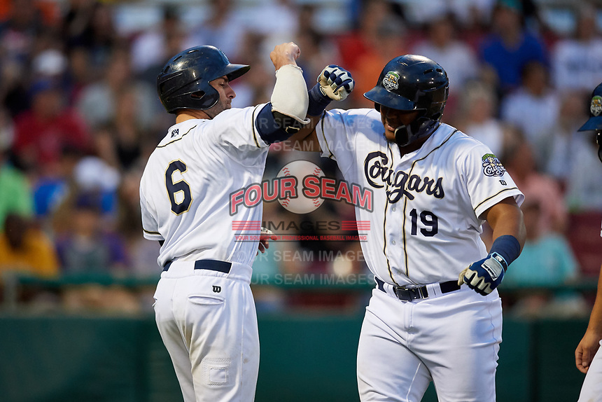 Kane County Cougars third baseman Eudy Ramos (19) is congratulated by catcher Tim Susnara (6) as he returns to the dugout after hitting a home run in the bottom of the fifth inning during a game against the West Michigan Whitecaps on July 19, 2018 at Northwestern Medicine Field in Geneva, Illinois.  Kane County defeated West Michigan 8-5.  (Mike Janes/Four Seam Images)