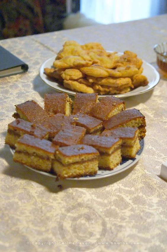 Montenegrin food speciality: sweet cake and fried bred Durovic Jovo Winery, Dupilo village, wine region south of Podgorica. Vukovici Durovic Jovo Winery near Dupilo. Montenegro, Balkan, Europe.
