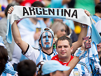 An Argentina fan holding a scarf