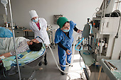 Surgeons, operating theatre nurses and an anaesthetist carry out a complex skin graft and lower leg operation in the recently privatised Centre for Re-creational Plastic Surgery and Thermal Affects, Tbilisi, the leading burns and reconstructive surgery hospital in the Caucasus region.  Many of Georgia's hospitals are facing the threat of privatisation.