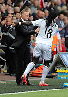 SWANSEA, WALES - MAY 17: Bafetimbi Gomis (R) of Swansea celebrates his goal with manager Garry Monk which made the score 2-2 during the Premier League match between Swansea City and Manchester City at The Liberty Stadium on May 17, 2015 in Swansea, Wales. (photo by Athena Pictures/Getty Images)