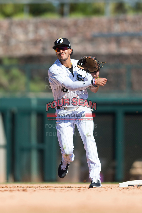 Glendale Desert Dogs second baseman Laz Rivera (8), of the Los Angeles Dodgers organization, throws to first base to try to complete a double play during an Arizona Fall League game against the Mesa Solar Sox at Camelback Ranch on October 15, 2018 in Glendale, Arizona. Mesa defeated Glendale 8-0. (Zachary Lucy/Four Seam Images)
