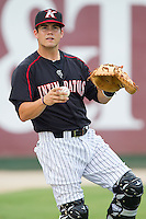 Kannapolis Intimidators catcher Brett Austin (10) warms up in the outfield prior to the game against the Charleston RiverDogs at CMC-NorthEast Stadium on June 27, 2014 in Kannapolis, North Carolina.  The Intimidators defeated the RiverDogs 6-5.  (Brian Westerholt/Four Seam Images)